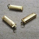 Brass charm Harmonica